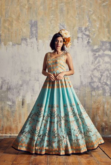 Mint Blue satin Linen Long dress with the combination of checks & floral prints & mosaic hand embroidered neckline with spiral organza scarf.