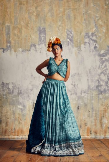 Teel Green lehenga set crafted in Tussar with intricate hand embroidery on top with crushed Russian silk dupatta