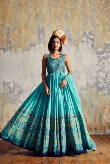 Aqua Green trendy Printed long dress in flowy Tussar embellished with intricate hand work along with organza dupatta