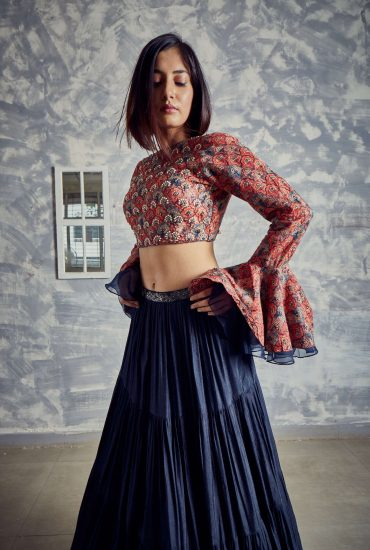 Midnight blue Tussar tiered skirt with delicate print and embroidered crop top and statement sleeves