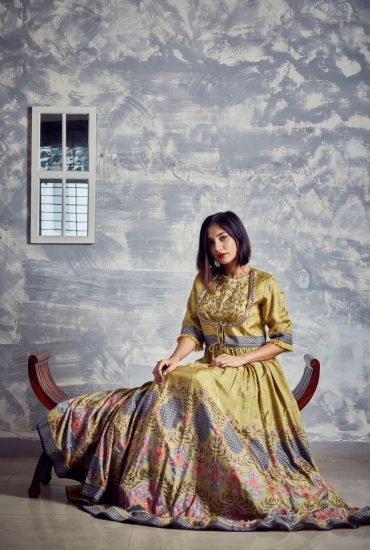 Corn yellow printed, and delicately hand embroidered long dress with front tie-up cut-out jacket in Tussar fabric